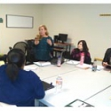 Monica Zarate, LMHC, Senior BSFT Model Manager trains a team of BSFT Therapists at JCCA.